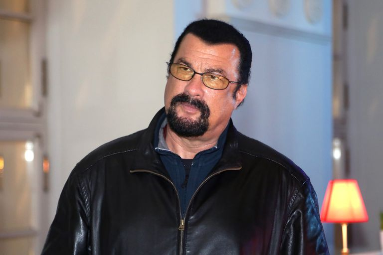 Steven Seagal wearing sunglasses and a leather jacket