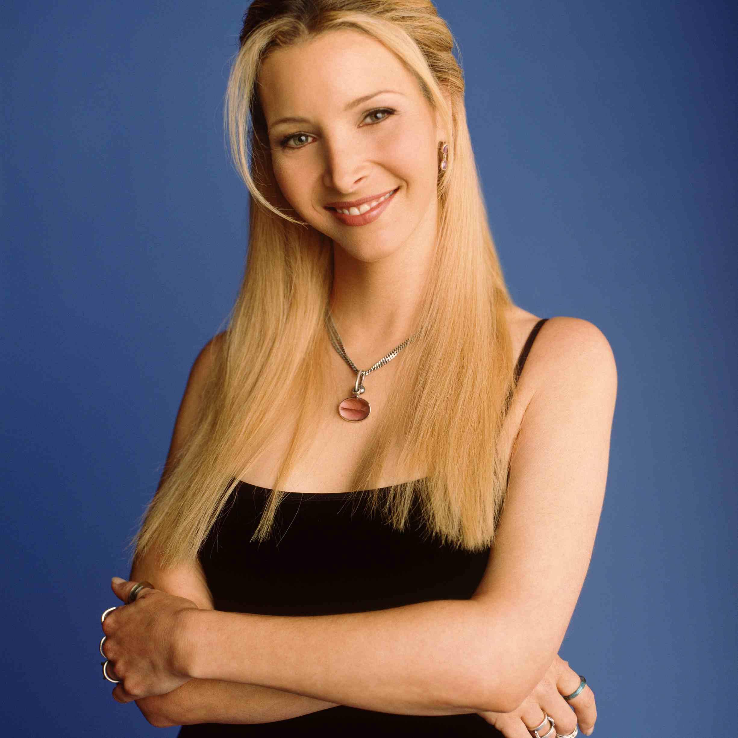 Portrait of Lisa Kudrow against blue background.