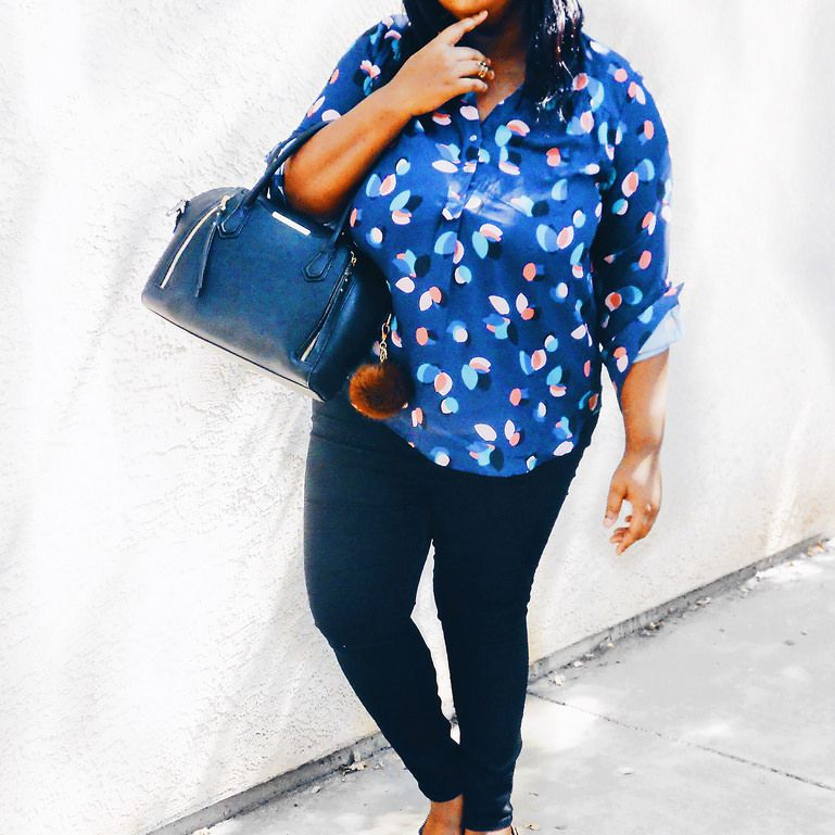 Woman in summer work outfit with blue blouse and jeans