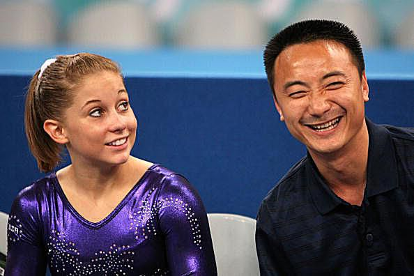 Gymnast Shawn Johnson with Her Coach Liang Chow at the 2008 Olympics