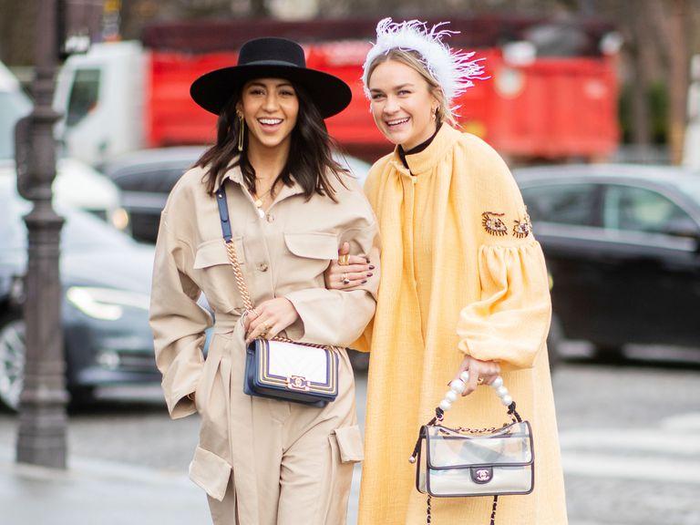Two women smiling at Paris Fashion Week fall/winter 2019