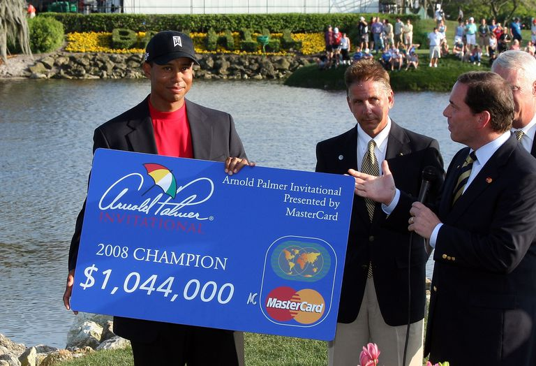 Tiger Woods collects the winner's check after the 2008 Arnold Palmer Invitational