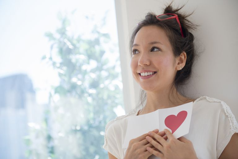 Woman holding Valentine's Day card