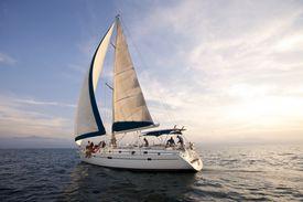 Sunset on the open ocean w/beautiful sailboat