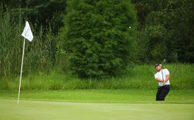 Merrick Bremner of South Africa pitches to thje 3rd green on the East Course during day three of the Joburg Open