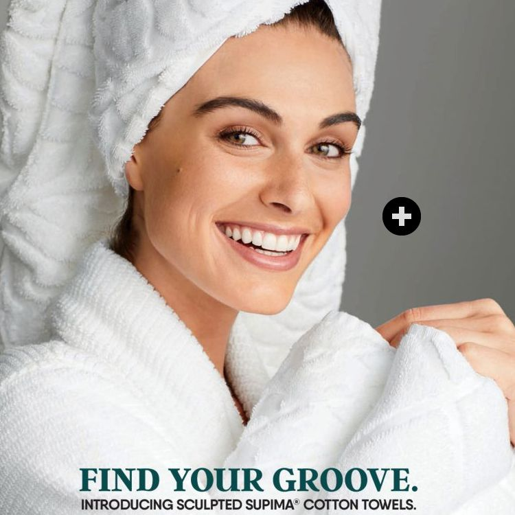 The Early Fall 2019 Lands' End Home catalog featuring a woman with white towels