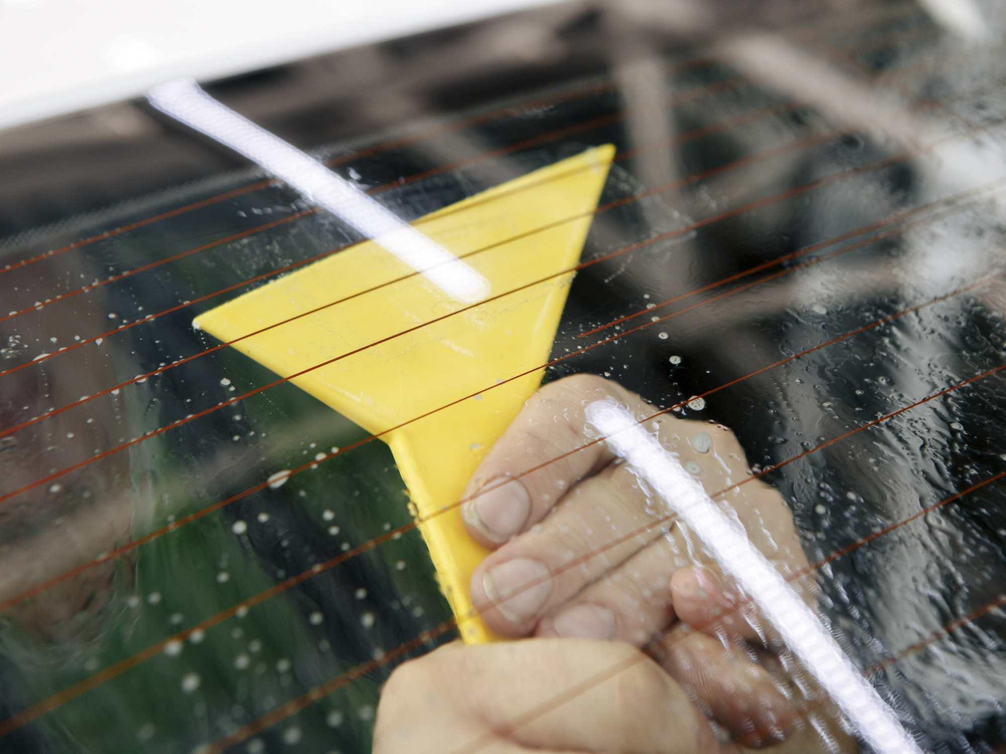 plastic scraper scraping window