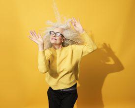 Mature woman dancing, smiling and having fun
