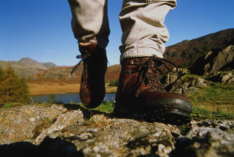 Person wearing hiking boots,walking across rocks,low section,England : Stock Photo CompEmbedShareADD TO BOARD Caption:Langdale, Lake District National Park, Cumbria, England. Blea Tarn and Langdale Pikes in background. Person wearing hiking boots,walking across rocks,low section,England