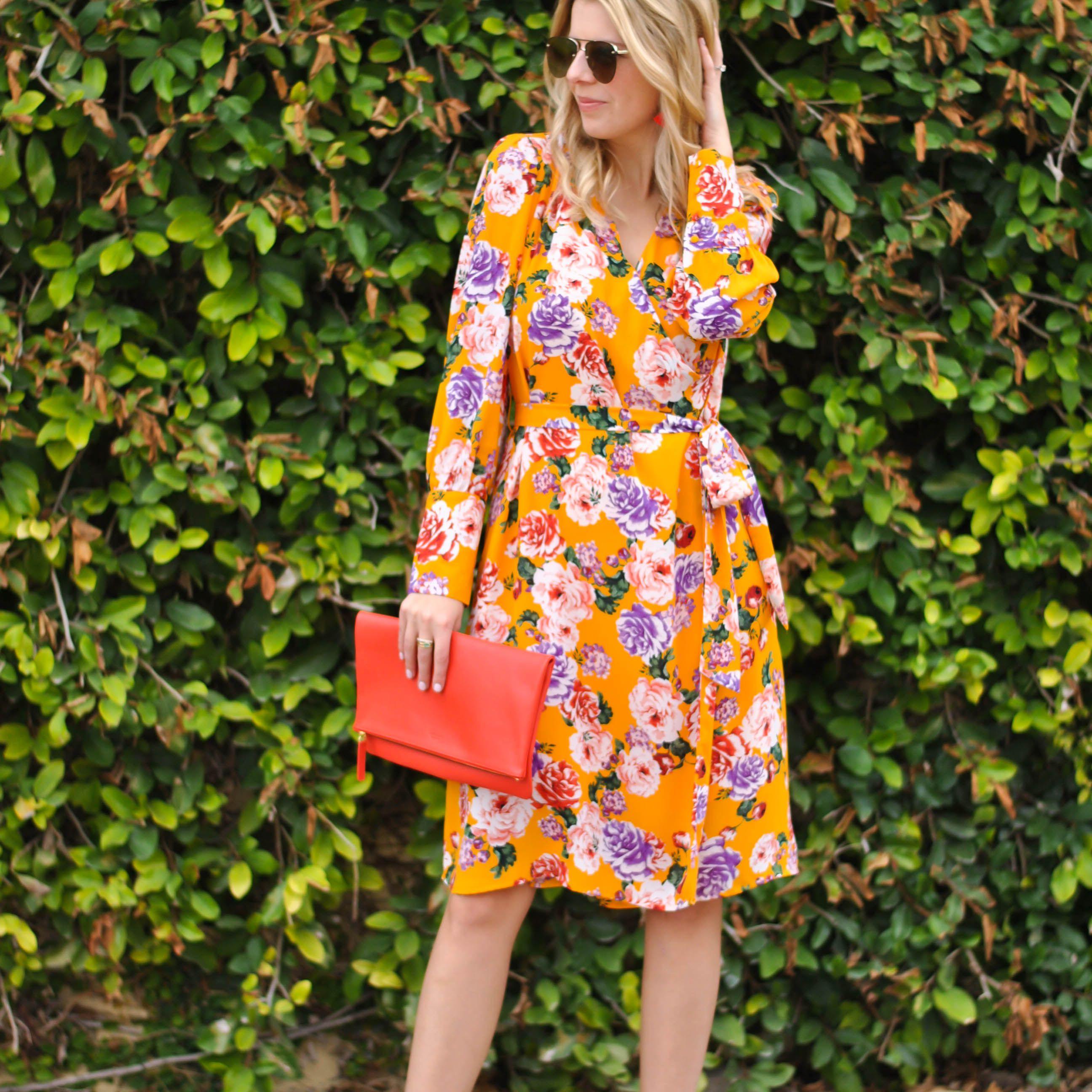 Woman in orange floral print dress