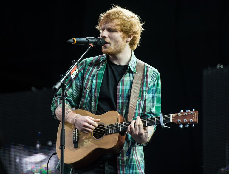 ed sheeran performing with guitar