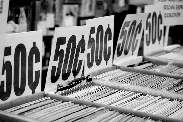 50 Cents signs on bins of comics for sale