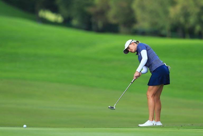 Golfer Sarah Jane Smith hits a long putt during an LPGA Tour tournament