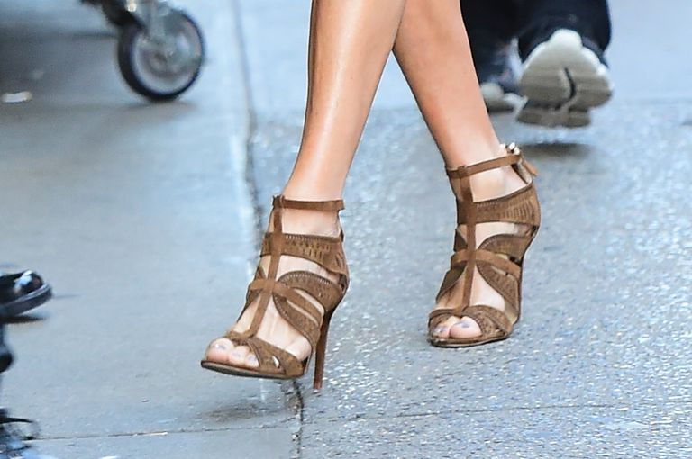 woman's feet in brown strappy high heels