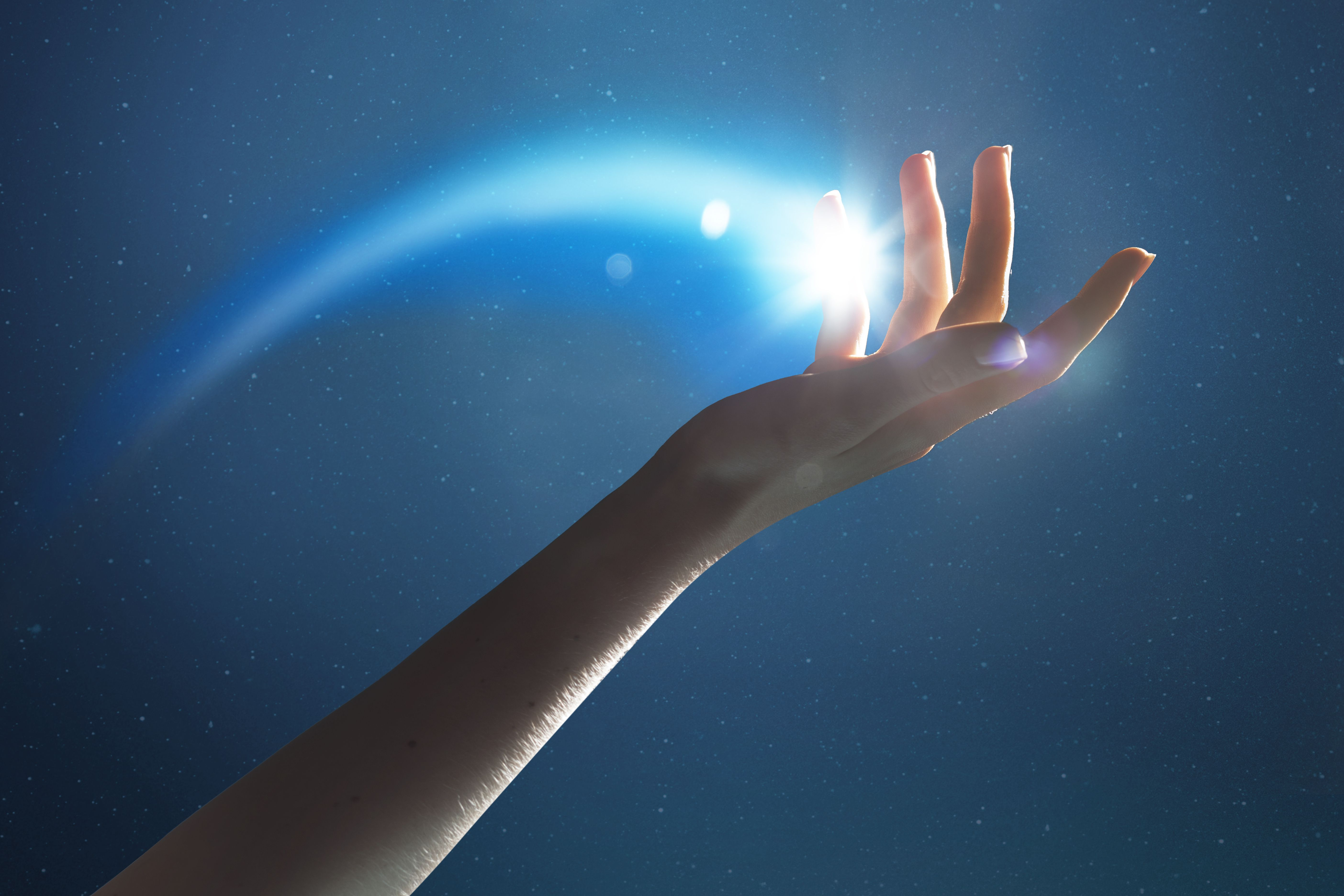 Hand holding a glowing shooting star