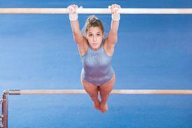 Teenage Gymnast on uneven bars