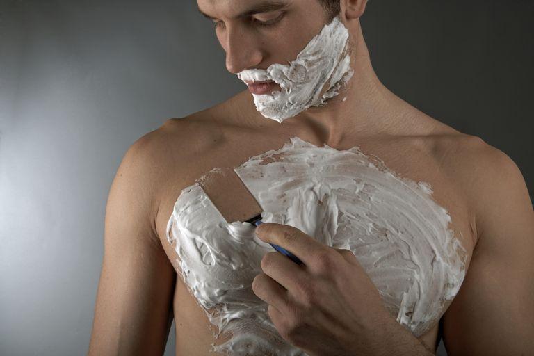 man shaving his chest