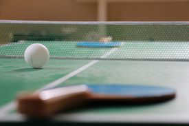 Ping-pong paddles and ball on a table