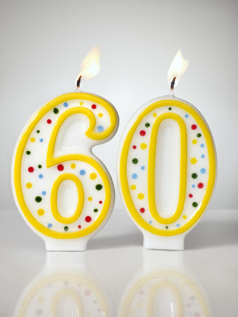 60th birthday candles aflame
