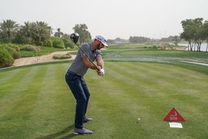 Dustin Johnson of the United States plays a driver off the 14th tee during the final round of the Abu Dhabi HSBC Golf Championship at the Abu Dhabi Golf Club on January 19, 2019