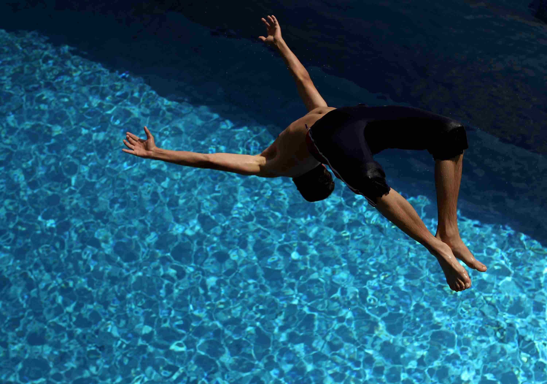 Springboard diver in a Public Pool