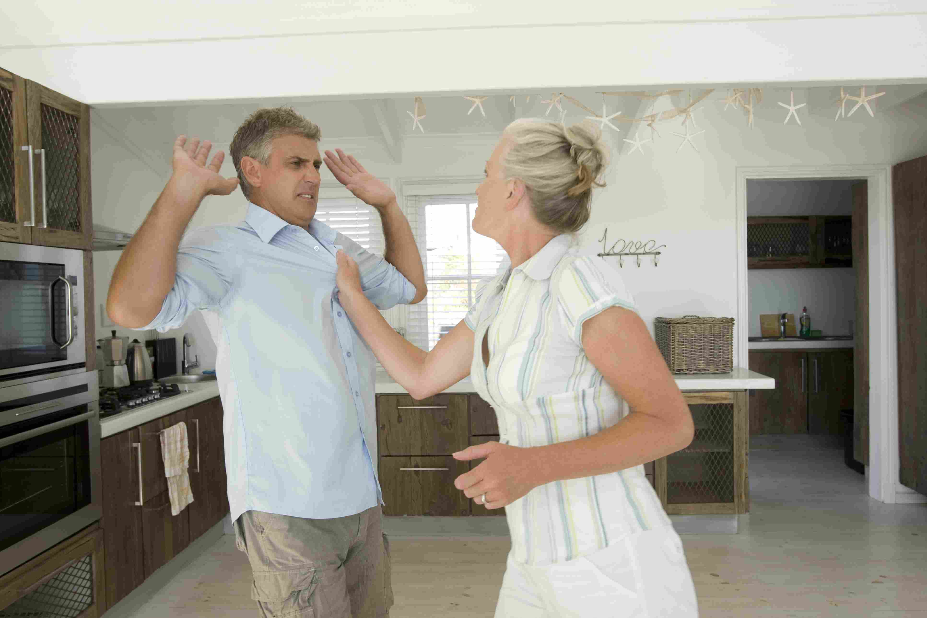 Mature couple fighting in kitchen