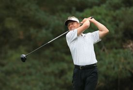 Golfer Chris Baron hits a drive during a qualifying tournament