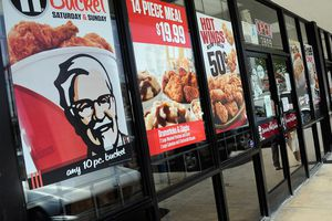 window ads for KFC advertising buckets of chicken and more