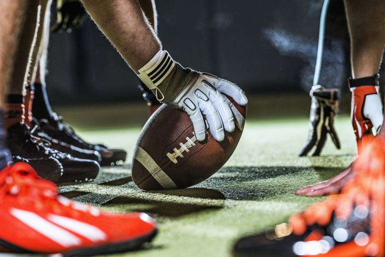 American football, close up of the snap