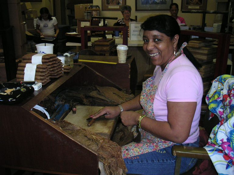 A woman hand-rolling cigars