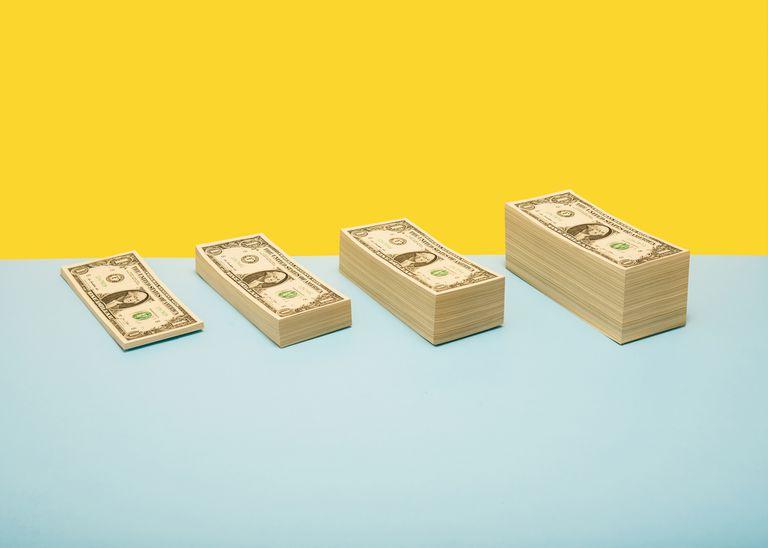 Stacks of US 1 dollar bills in ascending order