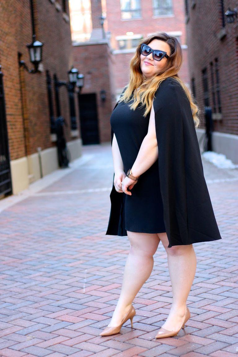 Street Style Woman in Black Cape Dress