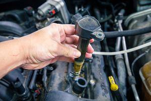 Car engine coils on a dirty engine