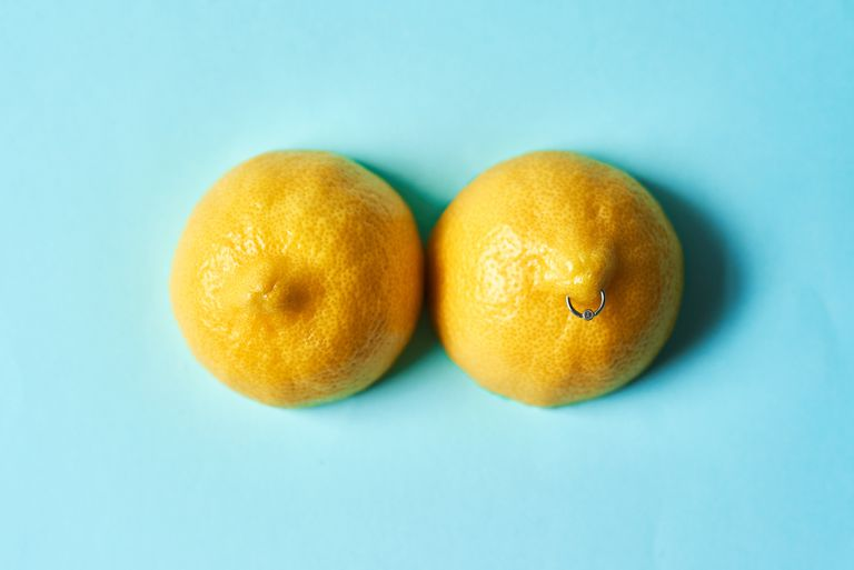 Lemons pierced to look like nipples on a blue background