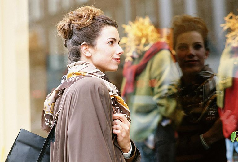 Woman looking in shop window