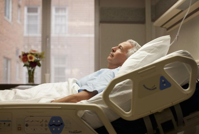 A man lying in a hospital bed