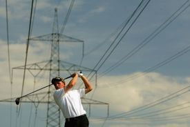 Luke Donald tees off in the shadow of huge power cables at Eichenried Golf Club in Germany