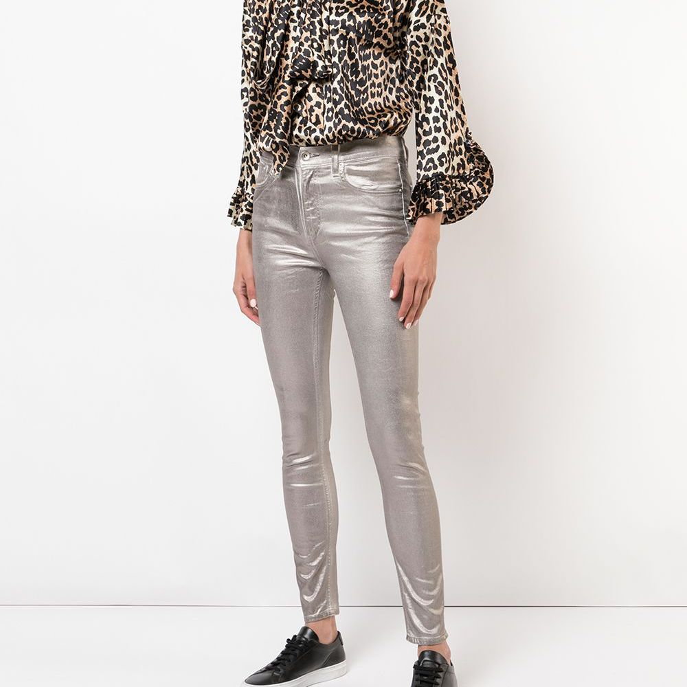 Woman in leopard print blouse and gold jeans