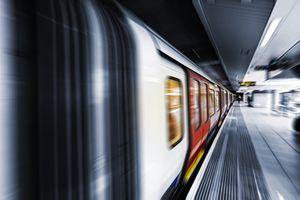 Train passing subway platform