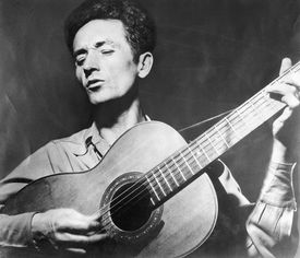 Woody Guthrie Playing the Guitar