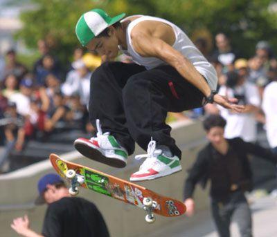 Skateboarder doing a 360 Pop Shove It