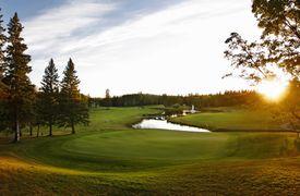 Golf course fairway with a water hazard