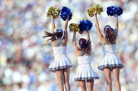 backs of cheerleaders in formation