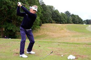 Bernhard Langer works on the golf practice range