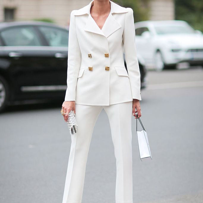 Woman in white pantsuit street style