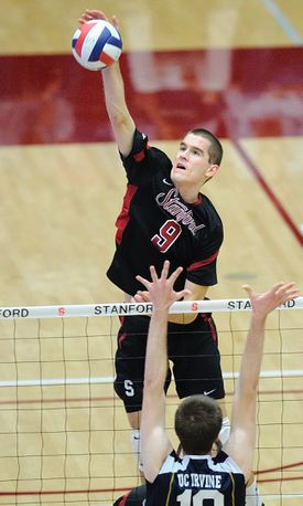 man spiking in volleyball