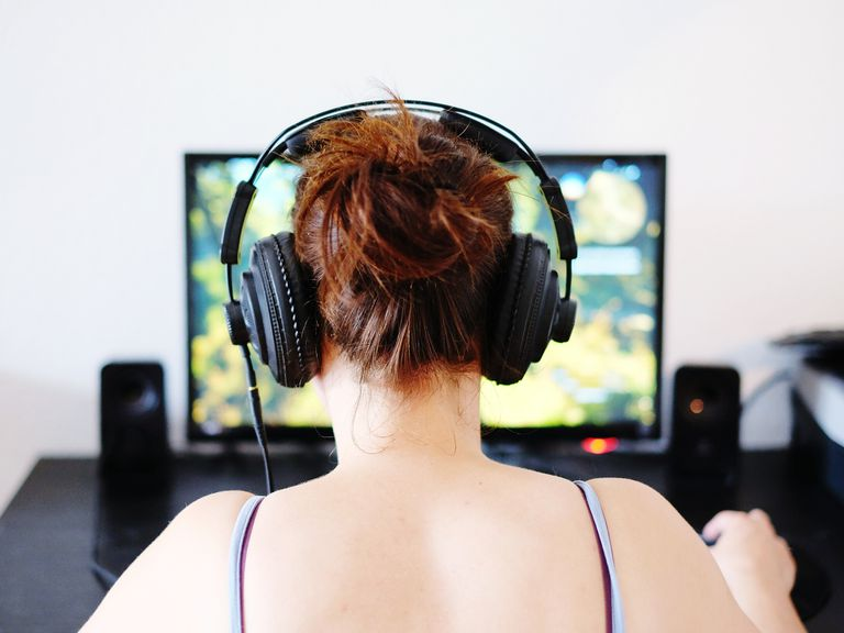 Rear View Of Woman Playing Video Games