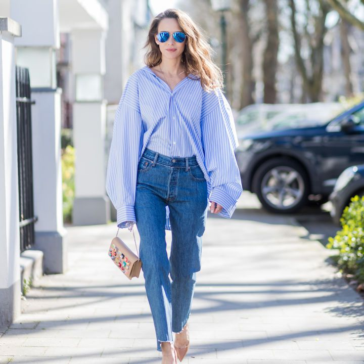 Street style in raw hem girlfriend jeans and a blouse