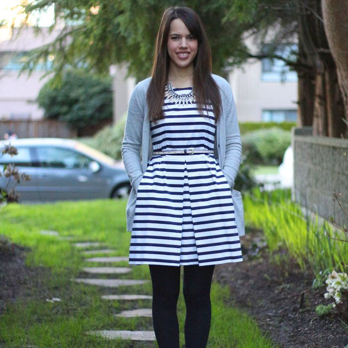 Woman in striped dress blue cardigan and tights