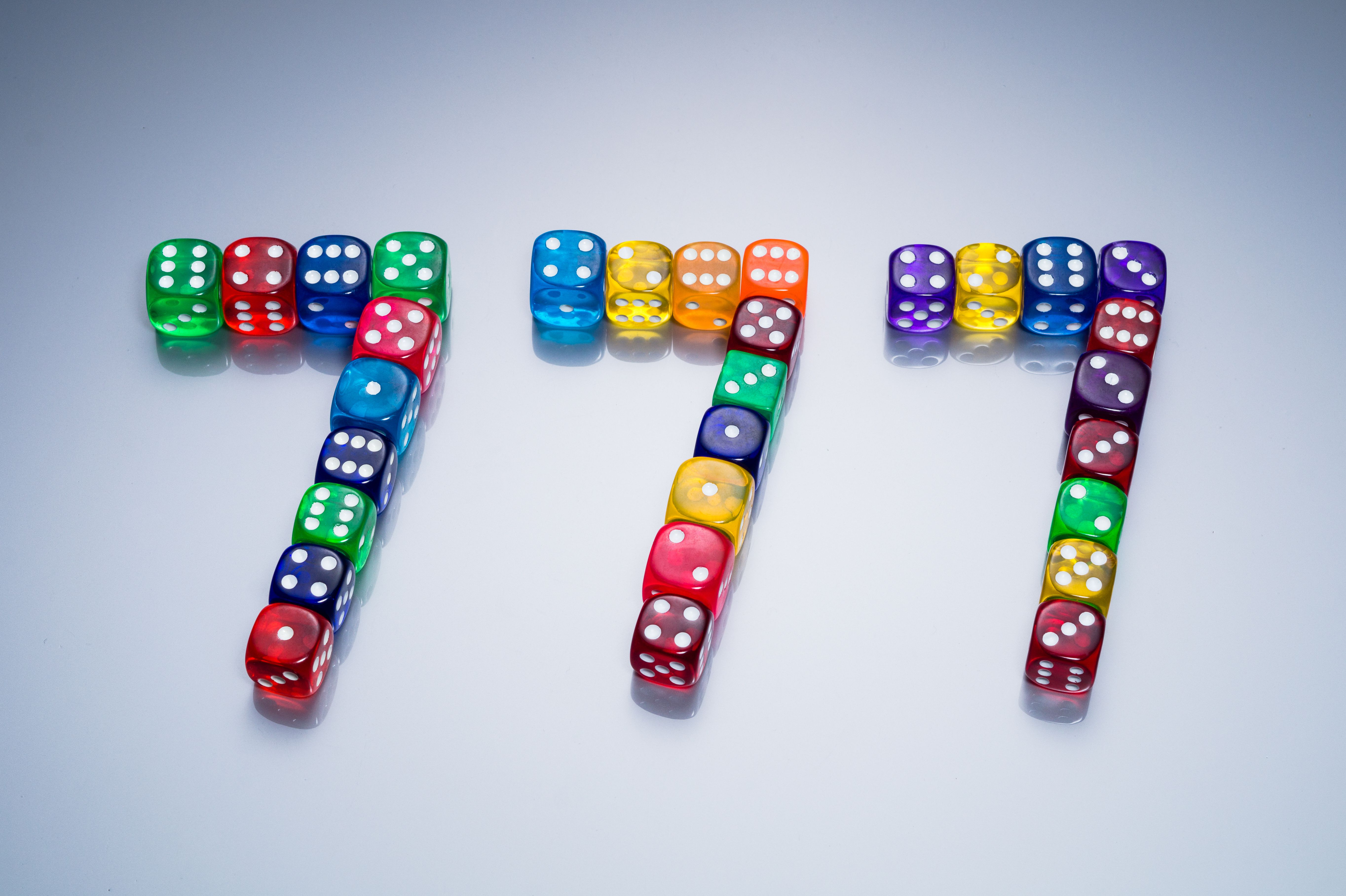 Slot Machine Lucky Triple 7 Consists of Colorful Dice